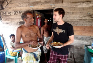 Sharing a meal in Sri Lanka fishing village
