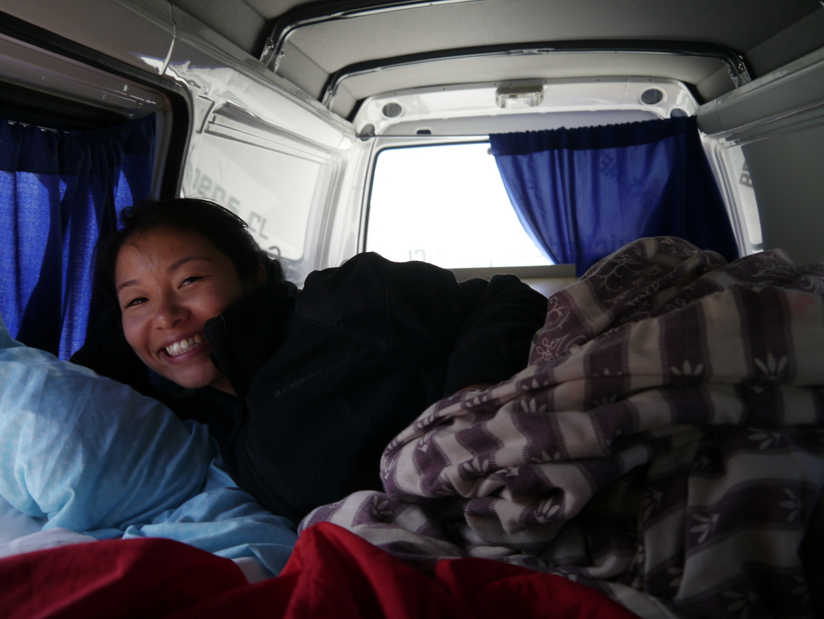 Rose sleeping in the back of the Wicked van patagonia chile